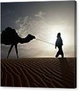Silhouette Of Berber Leading Camel Canvas Print