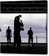 Silhouette Of Sailors In The Hangar Bay Canvas Print