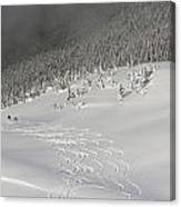 Skiers At The Base Of A Mountain Canvas Print