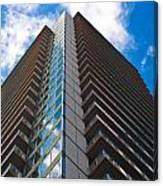 Skyscraper Front View With Blue Sky Canvas Print