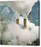 Smoking Chimneys Of A Paper Mill Polluting The Air Canvas Print