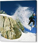 Snowboarder Jumping Off A Big Rock Canvas Print