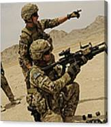 Soldier Directing A Fellow Soldier Canvas Print