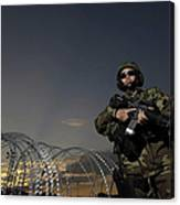 Soldier Patrols The Perimeter Of Camp Canvas Print