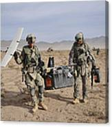 Soldiers Carry An Rq-11 Raven Unmanned Canvas Print