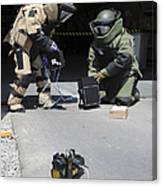 Soldiers Dressed In Bomb Suits Examine Canvas Print