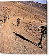 Soldiers Patrol To A Village Canvas Print