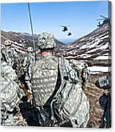 Soldiers Wait For Uh-60 Black Hawk Canvas Print