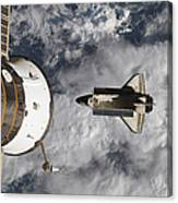 Space Shuttle Atlantis And The Docked Canvas Print