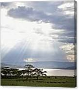 Sunlight Shines Down Through The Clouds Canvas Print