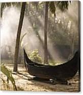 Sunlight Shining On A Canoe Canvas Print