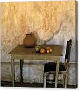Table And Chairs Infront Of Weathered Canvas Print