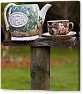 Teapot And Tea Cup On Old Post Canvas Print