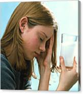Teenager With Headache Holds Dissolving Painkiller Canvas Print