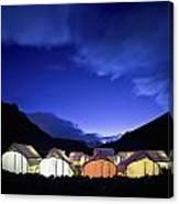 Tents Illuminated In A Valley At Night Canvas Print