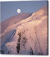 The Moon Rises Over Snow-blown Peaks Canvas Print