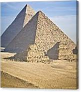 The Pyramids With Two Men On Camels Canvas Print