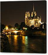 The Seine And Notre Dame At Night Canvas Print