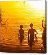 Three Young Kids Fishing On The Lake At Sunset Canvas Print