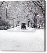 Tractor Driving Down A Snow Covered Road Canvas Print