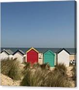 Traditional Beach Huts In The Sand Canvas Print