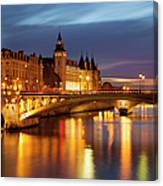 Twilight Over River Seine And Conciergerie Canvas Print