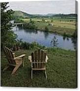 Two Adirondack Chairs On A Scenic Canvas Print