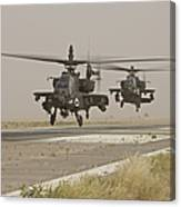 Two Ah-64 Apache Helicopters Prepare Canvas Print