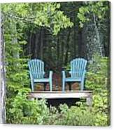 Two Chairs Sit At A Lakeside Camp Canvas Print