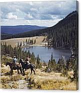 Two Horsemen Ride Above Pecos Baldy Canvas Print
