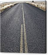 Two Lane Road Between Fenced Fields Canvas Print