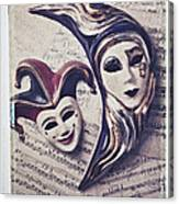 Two Masks On Sheet Music Canvas Print