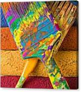 Two Paintbrushes On Paint Rollers Canvas Print