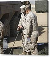 Two U.s. Marines Use A Mine Detector Canvas Print