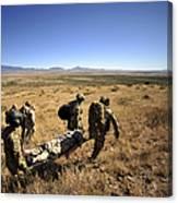 U.s. Air Force Pararescuemen Carry Canvas Print
