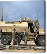U.s. Army Sergeant Refuels A Caiman Canvas Print