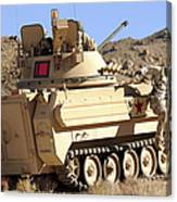 U.s. Army Soldier Jumps Off An M113 Canvas Print