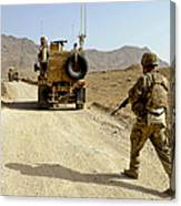 U.s. Army Soldier Moves To His Mrap Canvas Print
