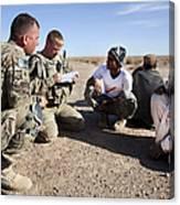 U.s. Army Soldiers Speak With Elders Canvas Print