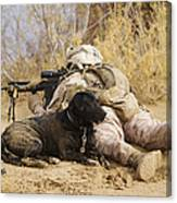 U.s. Marine And A Military Working Dog Canvas Print