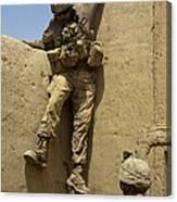 U.s. Marine Climbs Down From An Canvas Print