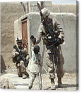 U.s. Marine Gives An Afghan Child Canvas Print