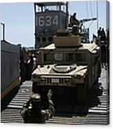 U.s. Marines Load An M1114 Humvee Onto Canvas Print