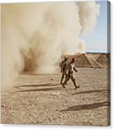 U.s. Marines Walk Away From A Dust Canvas Print