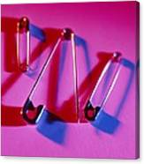 View Of Three Safety Pins Canvas Print