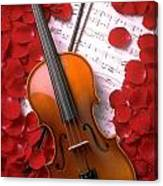 Violin On Sheet Music With Rose Petals Canvas Print