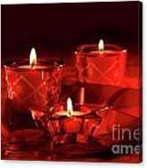 Votive Candles On Dark Red Background Canvas Print