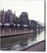 Walking The Dog Along The Seine Canvas Print