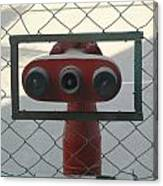 Water Hydrants Built Into A Wire Mesh Fence Canvas Print