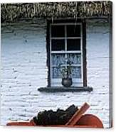 Wheelbarrow In Front Of A Window Of A Canvas Print